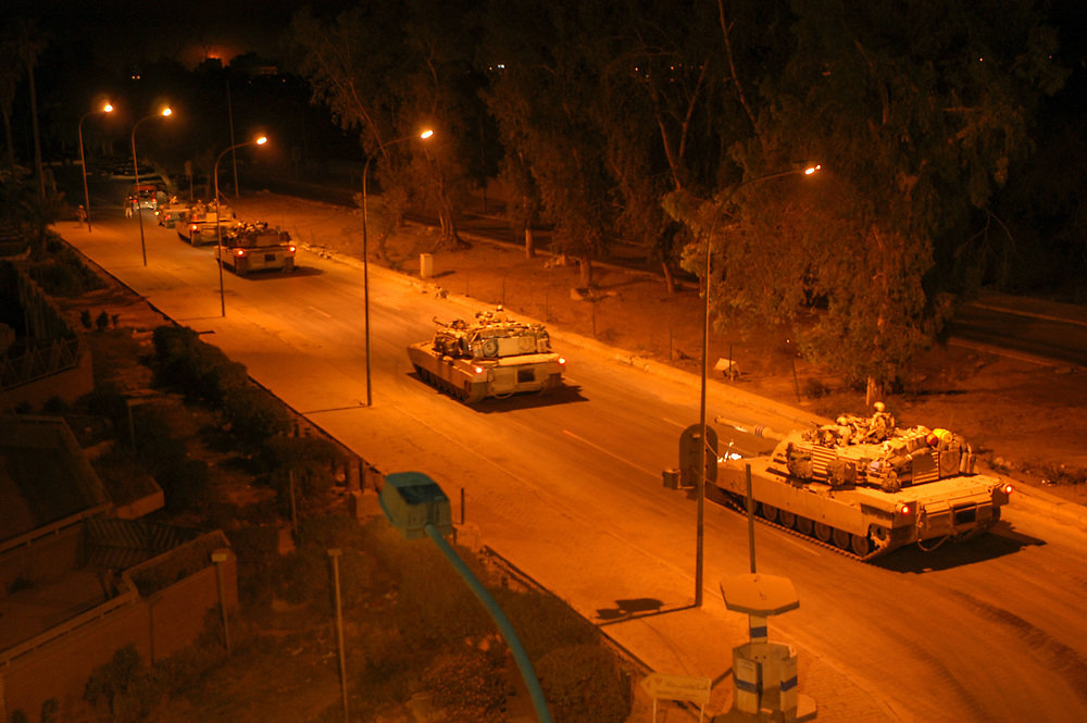 US tanks patrol the streets of Baghdad at night.<br /> Baghdad, Iraq. 03/05/2003.