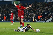 Kieran Gibbs goes over in the box after a tackle from Tommy Rowe during the EFL Sky Bet Championship match between West Bromwich Albion and Bristol City at The Hawthorns, West Bromwich, England on 27 November 2019.