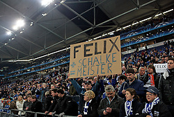 """Fans hold up a sign """"Felix + Schalke = Meister"""" during the UEFA Champions League round of 16 second leg match between Schalke 04 and Valencia at Veltins Arena on March 9, 2011 in Gelsenkirchen, Germany."""
