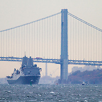 The USS New York built with steal salvaged from the World Trade Center Towers and after having been commissioned in a ceremony on November 8th in New York City sailes out from under the Varranzano-Narrows Bridge as it leaves New York City and New York Harbor.