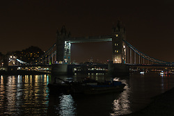 © Licensed to London News Pictures. 29/03/2014. London, UK. Tower Bridge turns the lights off in support of global Earth Hour 2014 at 8:30pm local time in London on 29th March 2014. Photo credit : Vickie Flores/LNP