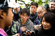 Japanese journalists surround Hideki Matsuyama. 2016 Masters<br /> Round Practice Round Wednesday<br /> Augusta National/Augusta, GA, <br /> 04/06/2016<br /> SI-14 TK1<br /> Credit: Darren Carroll