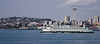 The Washington State Ferry, Wenatchee, leaves Seattle past the Space Needle to cross Puget Sound to Bainbridge Island. Washington, USA.