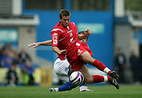 Photo: Rich Eaton.<br /> <br /> Millwall v Swindon Town. Coca Cola League 1. 29/09/2007. Swindon's Michael Pook is tackled.