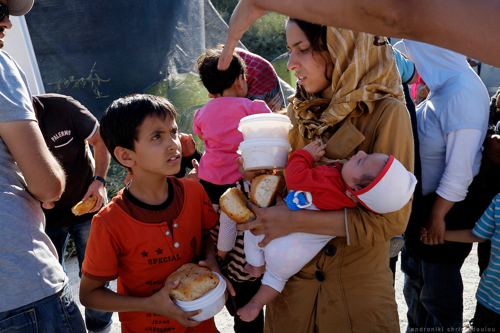 Food distribution.<br /> Moria refugee camp is a bit further out of Mytilene city and it is divided in two sections. The inner part is well organised with buildings and police guarding it, and the outer part where mainly Afghan refugees live in tents and is purely guarded with chaotic situations, mainly during food distribution, frequently occur.