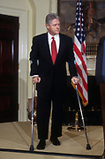 WASHINGTON, DC, USA - 1997/04/01: U.S. President Bill Clinton during statement on keeping liquor advertisement off television with Vice President Al Gore in the Roosevelt Room the White House April 1, 1997 in Washington, DC. Clinton is using crutches following knee surgery.    (Photo by Richard Ellis)