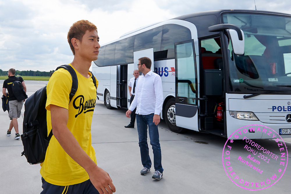 Dong-Won Ji of Dorussia Dortmund on Wroclaw's airport before international friendly soccer match between WKS Slask Wroclaw and BVB Borussia Dortmund on Municipal Stadium in Wroclaw, Poland.<br /> <br /> Poland, Wroclaw, August 6, 2014<br /> <br /> Picture also available in RAW (NEF) or TIFF format on special request.<br /> <br /> For editorial use only. Any commercial or promotional use requires permission.<br /> <br /> Mandatory credit:<br /> Photo by &copy; Adam Nurkiewicz / Mediasport