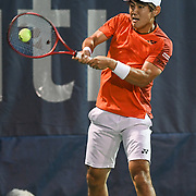 YOSHITO HISHIOKA hits a backhand at the Rock Creek Tennis Center.