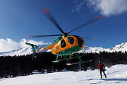 Italy, Madonna di Campiglio, Gino BRESADOLA welcome the military corp Guardia di Finanza helicopter at his refuge