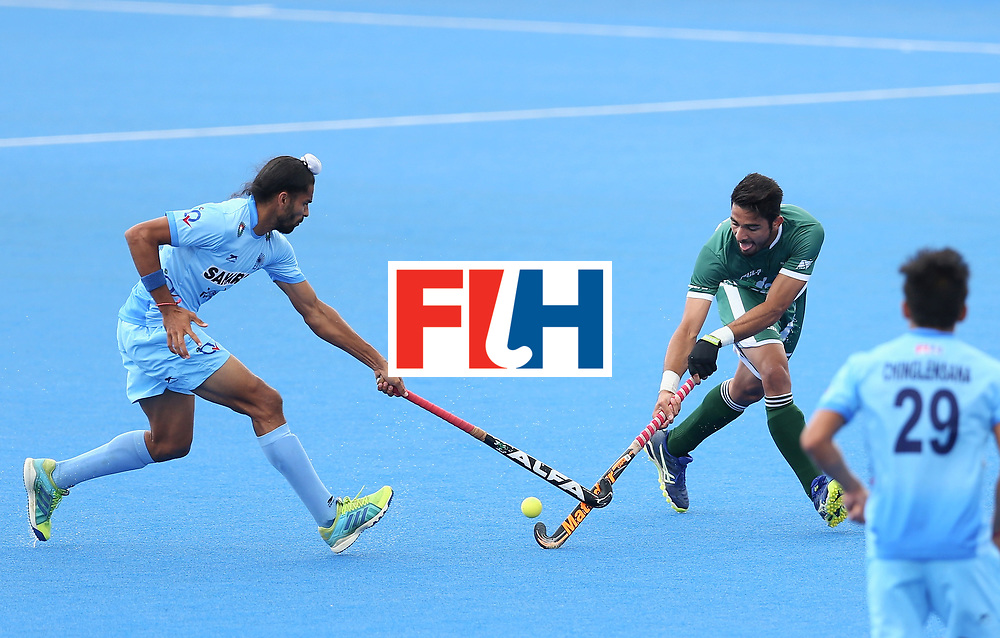 LONDON, ENGLAND - JUNE 24: Abu Mahmood of Pakistan takes on the Indian defence during the 5th-8th place match between Pakistan and India on day eight of the Hero Hockey World League Semi-Final at Lee Valley Hockey and Tennis Centre on June 24, 2017 in London, England. (Photo by Steve Bardens/Getty Images)