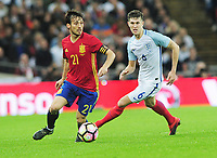 Football - 2016 / 2017 International Friendly - England vs. Spain<br /> <br /> David Silva of Spain and John Stones of England at Wembley.<br /> <br /> COLORSPORT/ANDREW COWIE