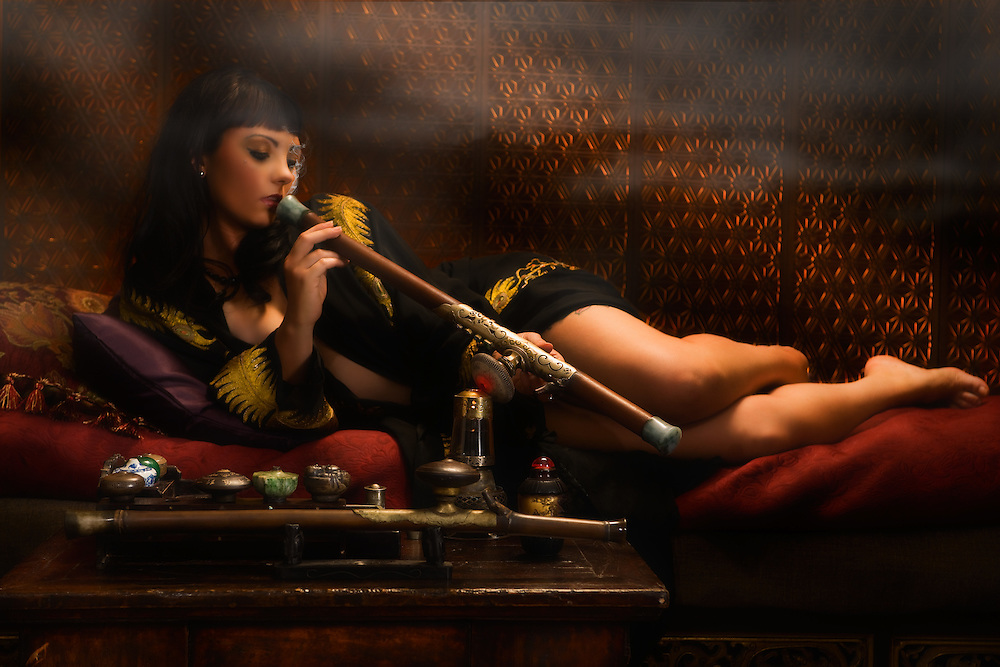 "Am I not desirable? Seductive, beautiful woman portrayed by alternative model Sabrina Sin, smoking opium in an ornate pipe, a forbidden pleasure among the liberated French females of the 1930's. This collection was inspired by the writings of Brassai in his book ""The Secret Paris of the 1930's""."