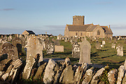 St Materiana's Church, on the cliffs between Trevena and Tintagel Castle, Tintagel, Cornwall, England. The church was built 1080-1150 although a church has stood here since the 6th century. It is Norman in design with some Saxon features, and a 13th or 15th century tower. The church and churchyard sit in King Arthur's country, an area steeped in the mysteries of Arthurian Legend. Picture by Manuel Cohen