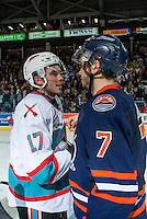 KELOWNA, CANADA - APRIL 4: Rodney Southam #17 of Kelowna Rockets shakes hands with former teammate Gage Quinney #7 of Kamloops Blazers on April 4, 2016 at Prospera Place in Kelowna, British Columbia, Canada.  (Photo by Marissa Baecker/Shoot the Breeze)  *** Local Caption *** Rodney Southam; Gage Quinney;