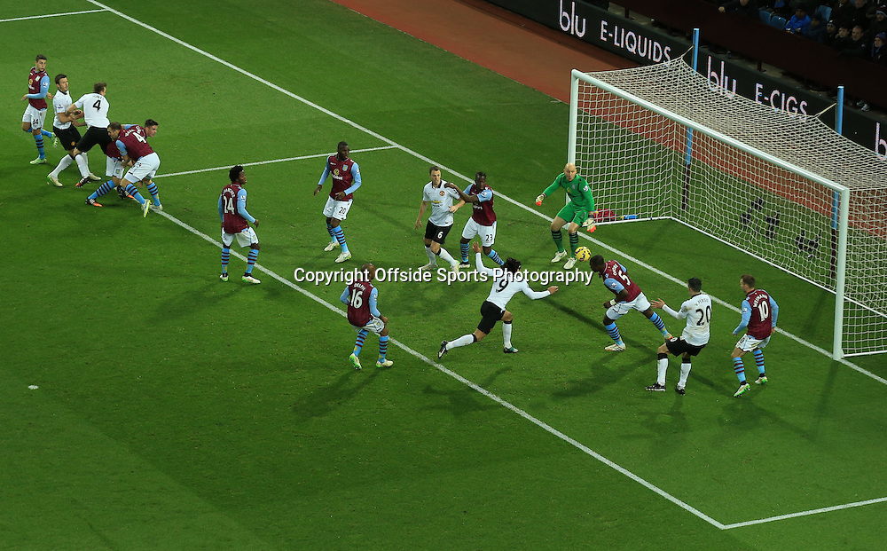 20 December 2014 - Barclays Premier League - Aston Villa v Manchester United - Jores Okore of Aston Villa clears the ball under pressure from Radamel Falcao of Manchester United - Photo: Marc Atkins / Offside.