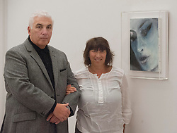 Mitch & Janice Winehouse view the portrait, Amy-Blue by Marlene Dumas, at the National Portrait Gallery, London, UK, November 26, 2012. Photo by i-Images.