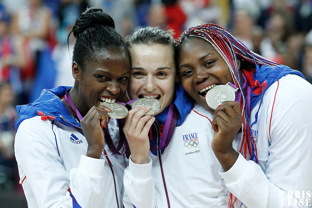 11 August 2012: France Emilie Gomis, Clemence Beikes and Isabelle Yacoubou pose with the silver medal following the 86-50 Team USA victory over Team France, during the Women's Gold Medal Game, at the North Greenwich Arena, in London, Great Britain.