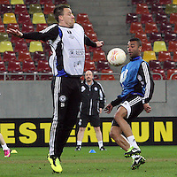 Chelsea's defender John Terry (L) and Chelsea's English defender Ashley Cole (R) vie for the ball during a training session on March 6, 2013 at the National Arena Stadium one day before the UEFA Europa League football match against Steaua Bucharest.