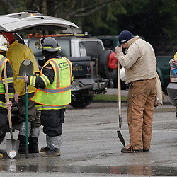 "Workers load shovels into a vehicle at the Darrington Fire Station as search work continues in the mud and debris from the massive Oso landslide in Darrington, Washington March 29, 2014. Family and friends of 90 people still missing after a wall of mud flattened the outskirts of a rural Washington state town increasingly feared for the worst on Saturday as the governor called for a statewide moment of silence a week after the disaster. ""The number is so big and it's so negative. It's hard to grasp,"" said 66-year-old Bob Michajla, a volunteer who has been helping search part of the square-mile (2.6 square-km) debris field. ""These are all friends and neighbors and family. Everybody knows everybody in this valley.""  REUTERS/Jason Redmond (UNITED STATES)"
