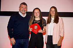 NEWPORT, WALES - Saturday, May 19, 2018: Bethan McGowan is presented with her Under-16's cap by Osian Roberts (left) and Lauren Dykes (right) during the Football Association of Wales Under-16's Caps Presentation at the Celtic Manor Resort. (Pic by David Rawcliffe/Propaganda)