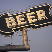Neon sign reading BEER in the shape of an arrow on top of Bar L Drive In barbecue restaurant in Wichita Falls, Texas, seen while on commercial photo shoot.