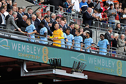 The Manchester City players receive their runners up medals after losing to Arsenal in the FA Community Shield - Photo mandatory by-line: Dougie Allward/JMP - Mobile: 07966 386802 10/08/2014 - SPORT - FOOTBALL - London - Wembley Stadium - Arsenal v Manchester City - FA Community Shield