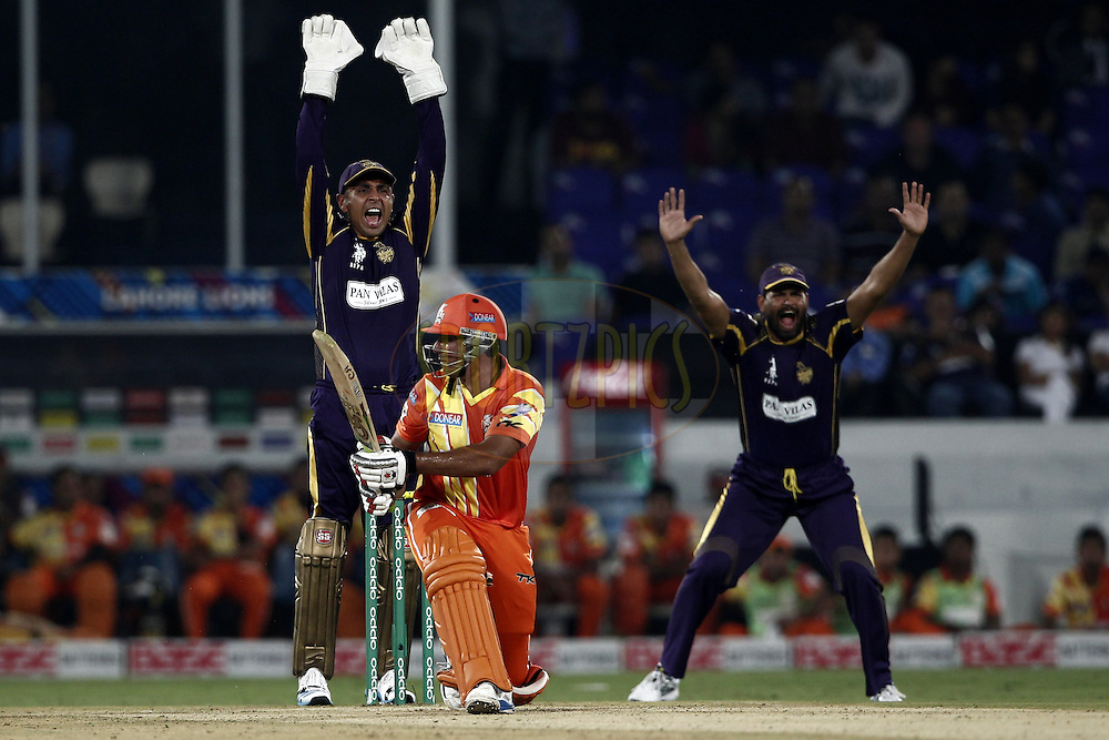 Manvinder Bisla , Yusuf Pathan of the Kolkata Knight Riders appealing during match 7 of the Oppo Champions League Twenty20 between the Kolkata Knight Riders and the Lahore Lions held at the Rajiv Gandhi Cricket Stadium, Hyderabad, India on the 21st September 2014<br /> <br /> Photo by:  Deepak Malik / Sportzpics/ CLT20<br /> <br /> <br /> Image use is subject to the terms and conditions as laid out by the BCCI/ CLT20.  The terms and conditions can be downloaded here:<br /> <br /> http://sportzpics.photoshelter.com/gallery/CLT20-Image-Terms-and-Conditions-2014/G0000IfNJn535VPU/C0000QhhKadWcjYs