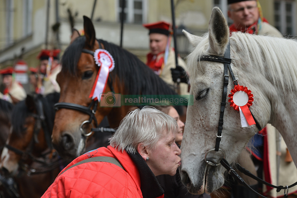 May 3, 2017 - Krakow, Poland - A woman kisses a horse as hundreds take part of the patriotic march from Wawel Hill trough Krakow's Old Town on Polish Constitution Day. The Constitution of May 3, 1791, was the world's second-oldest codified national constitution, but remained in force only for less than 19 months. (Credit Image: © Artur Widak/NurPhoto via ZUMA Press)