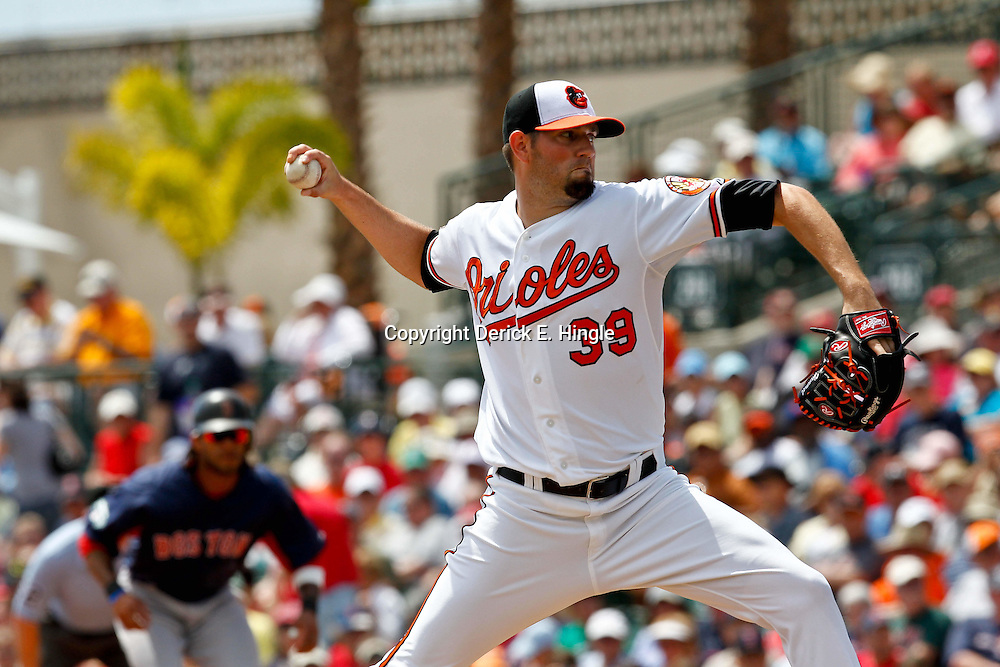 March 23, 2012; Sarasota, FL, USA; Baltimore Orioles pitcher Jason Hammel (39) throws during the top of the second inning of a spring training game against the Boston Red Sox at Ed Smith Stadium.  Mandatory Credit: Derick E. Hingle-US PRESSWIRE