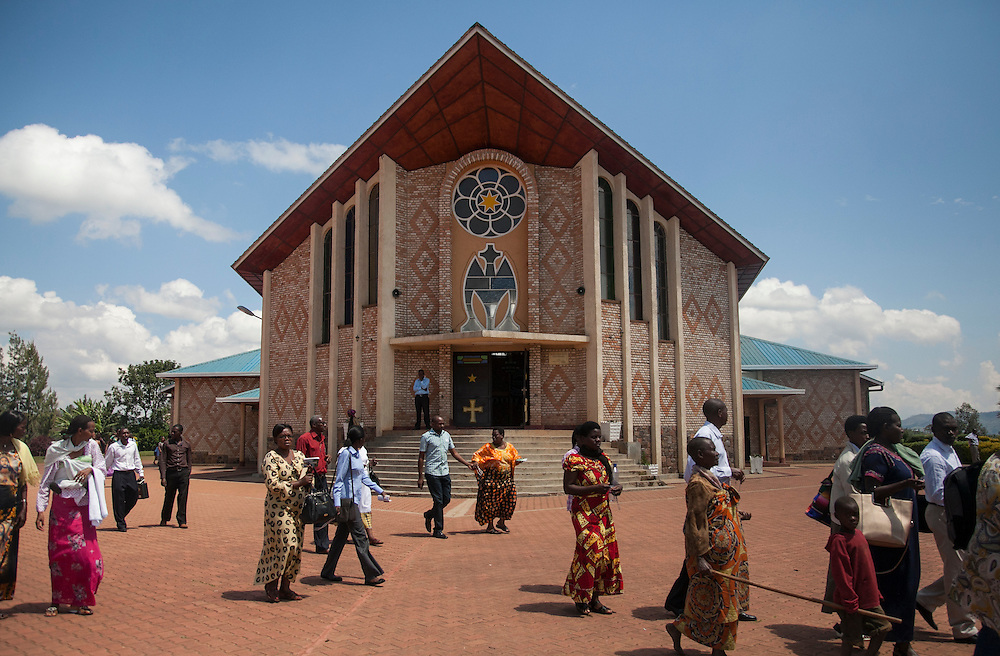 People leave mass at the Shrine of Our Lady of Sorrows in Kibeho, Rwanda, on Sunday, October 26, 2014. This is the only sanctioned Marian sanctuary in Africa. The Virgin Mary appeared here in 1981to three young women, one of whom still lives near the church grounds.<br /> <br /> The Rwanda Development Board, the government agency in charge of tourism, is pushing Kibeho as a tourist destination, and as such, plans to pave the dirt road in the next two years. The government is also encouraging private investors to build hotels and other tourism-related infrastructure.<br /> <br /> Photo by Laura Elizabeth Pohl