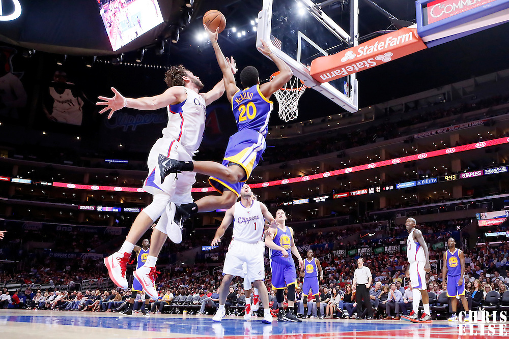 07 October 2014: Golden State Warriors forward James Michael McAdoo (20) goes for the layup past Los Angeles Clippers forward Spencer Hawes (10) during the Golden State Warriors 112-94 victory over the Los Angeles Clipper, in preseason opener, at the Staples Center, Los Angeles, California, USA.