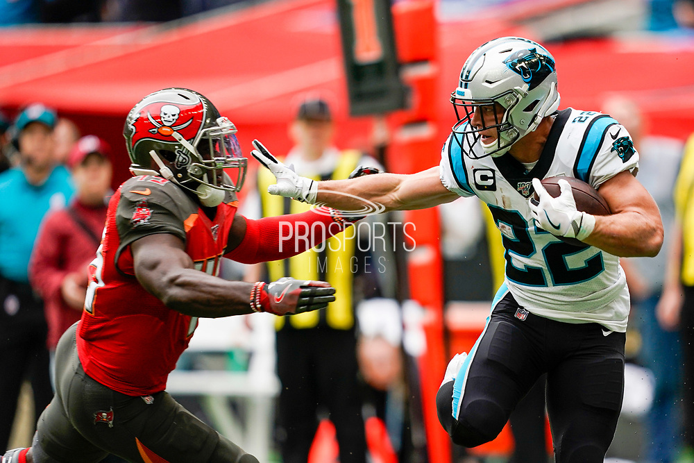 Carolina Panthers Running Back Christian McCaffrey (22) stiff arm during the International Series match between Tampa Bay Buccaneers and Carolina Panthers at Tottenham Hotspur Stadium, London, United Kingdom on 13 October 2019.