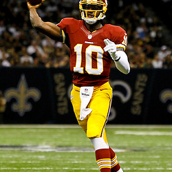 September 9, 2012; New Orleans, LA, USA; Washington Redskins quarterback Robert Griffin III (10) throws against the New Orleans Saints during the first half of a game at the Mercedes-Benz Superdome.  The Redskins defeated the Saints 40-32.  Mandatory Credit: Derick E. Hingle-US PRESSWIRE