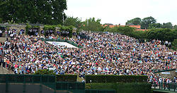 © Licensed to London News Pictures. 6th July 2014. London. UK. Fans on Murray Mound. Crowds and celebrities watch the The Men's Final between Roger Federer, SUI v Novak Djokovic, SER at the Wimbledon Tennis Championships 2014. Photo credit :  Mike King/LNP