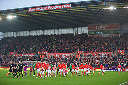 STOKE-ON-TRENT, ENGLAND - Sunday, January 4, 2015: Stoke City and Wrexham players walk out before the FA Cup 3rd Round match at the Britannia Stadium. (Pic by David Rawcliffe/Propaganda)