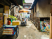 30 JULY 2016 - BANGKOK, THAILAND:  Food carts in the Pom Mahakan Fort slum. Residents of the slum have been told they must leave the fort and that their community will be torn down. Mahakan Fort was built in 1783 during the reign of Siamese King Rama I. It was one of 14 fortresses designed to protect Bangkok from foreign invaders. Only of two are remaining, the others have been torn down. A community developed in the fort when people started building houses and moving into it during the reign of King Rama V (1868-1910). The land was expropriated by Bangkok city government in 1992, but the people living in the fort refused to move. In 2004 courts ruled against the residents and said the city could take the land. Eviction notices have been posted in the community and people given until April 30 to leave, but most residents have refused to move. Residents think Bangkok city officials will start evictions around August 15, but there has not been any official word from the city.     PHOTO BY JACK KURTZ