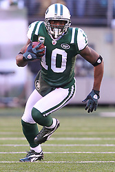 Dec 24, 2011; East Rutherford, NJ, USA; New York Jets wide receiver Santonio Holmes (10) runs with the ball after catching a pass from New York Jets quarterback Mark Sanchez (6) during the first half of their game against the New York Giants at MetLife Stadium.