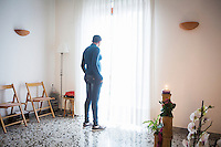 CASERTA, ITALY - 25 FEBRUARY 2015: A Nigerian immigrant and ex-sex worker poses for a portrait in the chappel of Casa Rut, a shelter for abused young immigrant women where she is hosted in Caserta, Italy, on February 25th 2015.<br /> <br /> Casa Rut was founded in 1995 and it is promoted and managed by the Ursuline Sisters of the Sacred Heart of Mary of Breganze (Vicenza, Italy).  Casa Rut's goal is to provide young immigrant women a familiar environment where  they are helped to protect and free themselves, and to undertake a common path aiming to the integration in Italy's society.