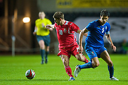 SWANSEA, ENGLAND - Friday, September 4, 2009: Wales' Ched Evans in action against Italy's Andrea Ranocchia during the UEFA Under 21 Championship Qualifying Group 3 match at the Liberty Stadium. (Photo by David Rawcliffe/Propaganda)