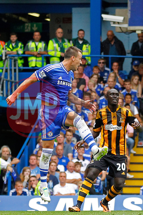 Chelsea's John Terry and Hull City's Yannick Sagbo  - Photo mandatory by-line: Mitchell Gunn/JMP - Tel: Mobile: 07966 386802 18/08/2013 - SPORT - FOOTBALL - Stamford Bridge - London -  Chelsea v Hull City - Barclays Premier League