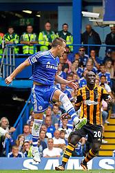 Chelsea's John Terry and Hull City's Yannick Sagbo  - Photo mandatory by-line: Mitchell Gunn/JMP - Tel: Mobile: 07966 386802 18/08/2013 - SPORT - FOOTBALL - Stamford Bridge - London -  Chelsea v Hull City - Barclays Premier League