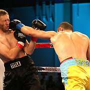 Arman Rysbek (R) lands a straight right to the face of John Morehouse during a Telemundo boxing match between at Osceola Heritage Park on Friday, February 23, 2018 in Kissimmee, Florida.  (Alex Menendez via AP)