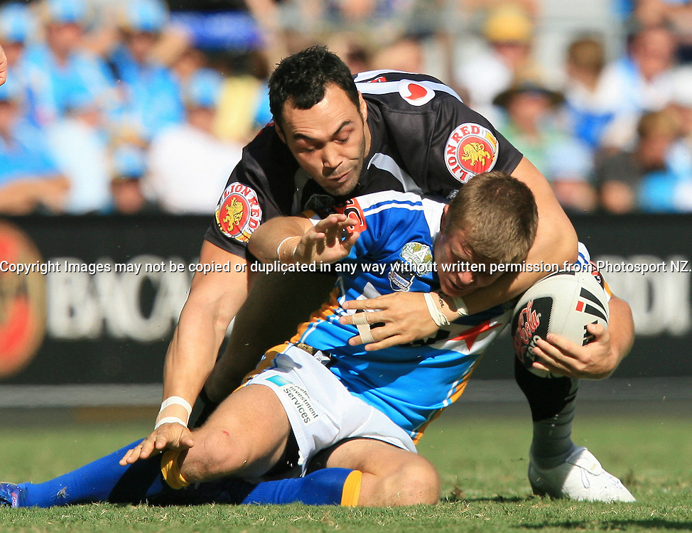 Sam Rapira solid in defense during round 7 of the NRL - Gold Coast Titans v New Zealand Warriors. Played at Skilled Stadium, Robina QLD. Titans (36) defeated the Warriors (24).  Photo: Warren Keir (Photosport NZ).<br /> <br /> Use information: This image is intended for Editorial use only (e.g. news or commentary, print or electronic). Any commercial or promotional use requires additional clearance.
