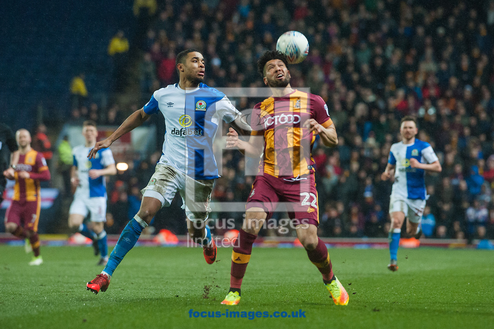 Nat Knight-Percival of Bradford City attempts to control the ball ahead of Dominic Samuel of Blackburn Rovers during the Sky Bet League 1 match at Ewood Park, Blackburn<br /> Picture by Matt Wilkinson/Focus Images Ltd 07814 960751<br /> 29/03/2018