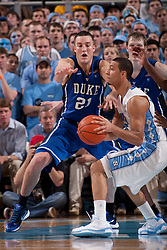 CHAPEL HILL, NC - MARCH 05: Miles Plumlee #21 of the Duke Blue Devils defends Kendall Marshall #5 of the North Carolina Tar Heels on March 05, 2011 at the Dean E. Smith Center in Chapel Hill, North Carolina. North Carolina won 67-81. (Photo by Peyton Williams/UNC/Getty Images) *** Local Caption *** Miles Plumlee;Kendall Marshall