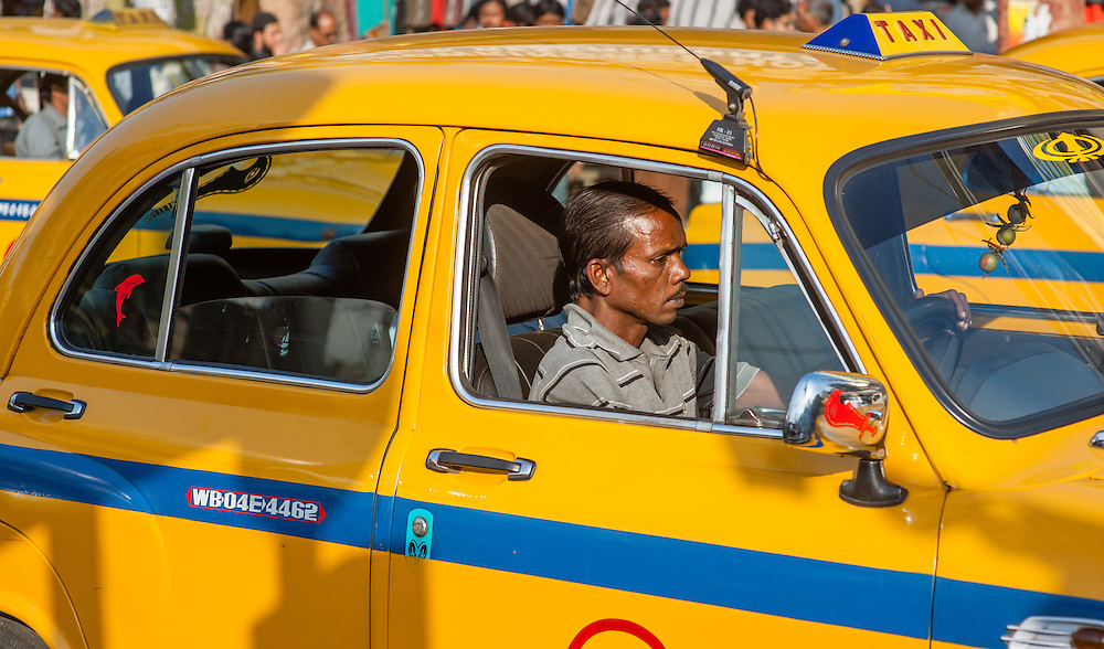 Yellow cab driver in Kolkata (India)
