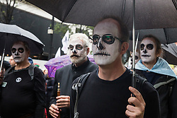 London, UK. 12 October, 2019. Climate activists from Extinction Rebellion with painted faces take part in the XR funeral march from Marble Arch to Russell Square on the sixth day of International Rebellion protests to demand a government declaration of a climate and ecological emergency, a commitment to halting biodiversity loss and net zero carbon emissions by 2025 and for the government to create and be led by the decisions of a Citizens' Assembly on climate and ecological justice. Credit: Mark Kerrison/Alamy Live News