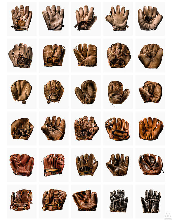 An arrangement of collectible vintage baseball gloves and mitts in multiple rows