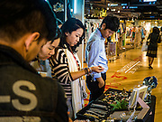 29 JANUARY 2016 - BANGKOK, THAILAND: People shop in Siam Center, one of the trendiest malls in Bangkok. It's in the middle of Bangkok's exclusive retail area.        PHOTO BY JACK KURTZ