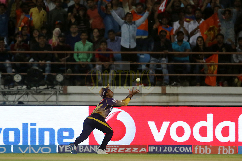 Kuldeep Yadav of the Kolkata Knight Riders tries to take a catch of Gujarat Lions captain Suresh Raina during match 3 of the Vivo 2017 Indian Premier League between the Gujarat Lions and the Kolkata Knight Riders held at the Saurashtra Cricket Association Stadium in Rajkot, India on the 7th April 2017<br /> <br /> Photo by Vipin Pawar - IPL - Sportzpics
